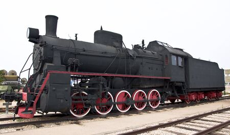 Steam locomotive beside a railway station platform. Retro train. Zdjęcie Seryjne - 7632316
