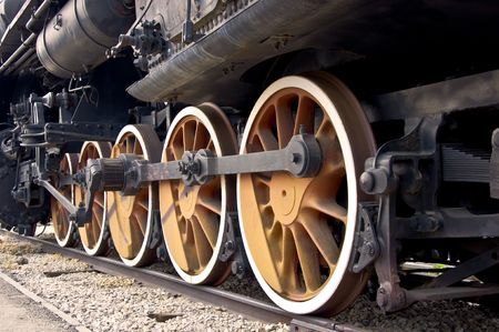 Old locomotive wheels close up. Steam train. Stock Photo