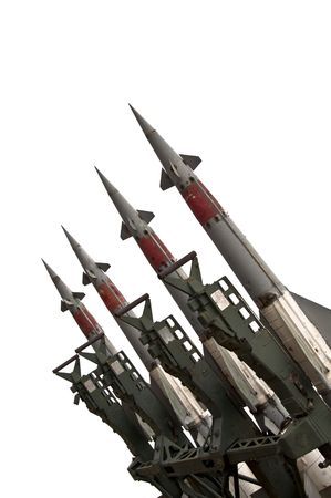 Several combat missiles aimed at the sky. Isolated on a white background. Missile weapons. photo