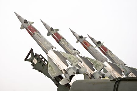 Several combat missiles aimed at the sky. Isolated on a white background. Missile weapons. Stock Photo