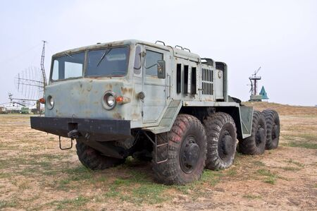 pitting: Old Army heavy rocket truck all-terrain vehicle. Used to move the missiles and military equipment.
