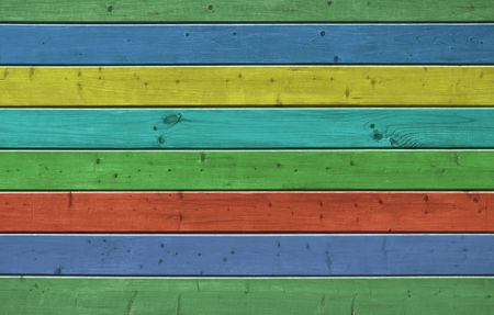 Wall of pine multicolor wood board. Lining closeup, frontally. Stock Photo