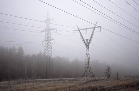 reliance: Reliance power lines in the morning fog. Silhouettes. Stock Photo