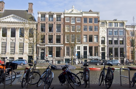Amsterdam residential houses and bicycle. Spring cityscape photo