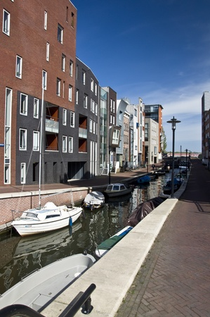 Modern residential houses on the canal in Amsterdam. Spring cityscape. Stock Photo - 9449876