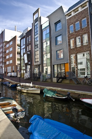 Modern residential houses on the canal in Amsterdam. Spring cityscape. Stock Photo - 9449875