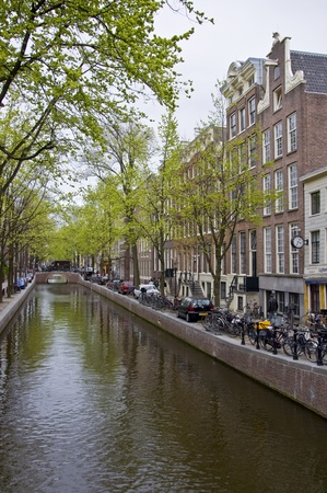 Canal in Amsterdam. Spring cityscape. Bicycles are on the waterfront. Stock Photo - 9452046