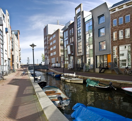 Modern residential houses on the canal in Amsterdam. Spring cityscape. Stock Photo - 9452043