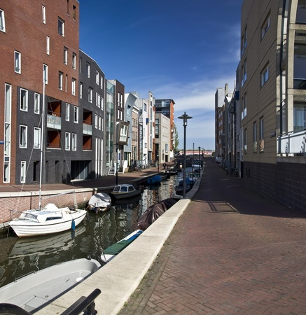 Modern residential houses on the canal in Amsterdam. Spring cityscape. Stock Photo - 9452040