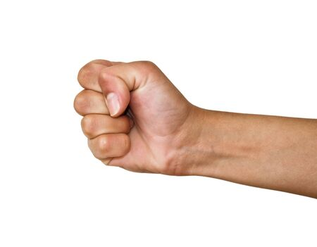 Fist on a white background. Human female hand. Studio shot.