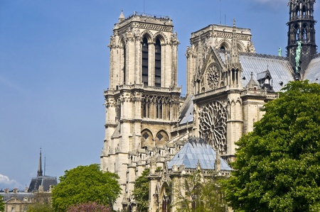 pitched roof: Notre Dame de Paris. A fragment of the towers against the blue clear sky. Paris, France. Stock Photo