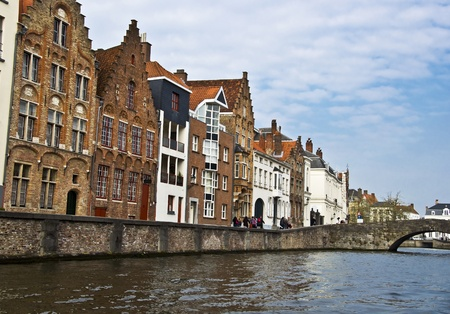 brugge: Bruges. Belgium. Medieval houses on the canal. Town Quay and the bridge. Typical building in Bruges. Stock Photo