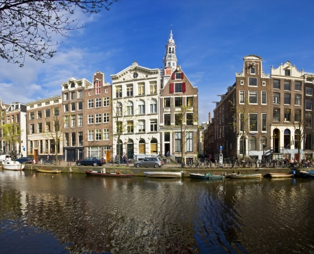 specificity: Amsterdam Life. Residential homes on the canal. Urban scene. Spring.