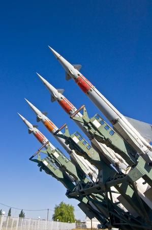 missiles: Antiaircraft rockets on the launcher against blue sky.