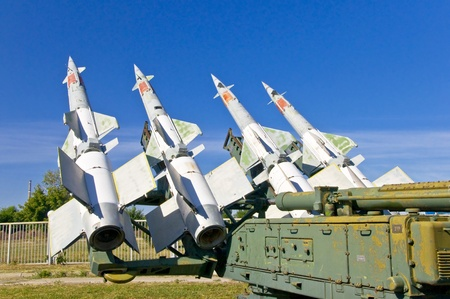 Antiaircraft rockets on the launcher against blue sky. photo