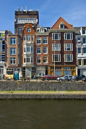 specificity: Classic amsterdam view. Residential homes on the canal. Urban scene. Spring. Editorial