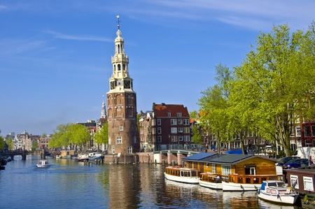 Classical Amsterdam view. Boat floats on the channel on the background of bridge. Urban scene. Stock Photo - 10363946