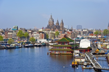 Classical Amsterdam view. Boat floats on the channel on the background of bridge. Urban scene. Stock Photo - 10363945