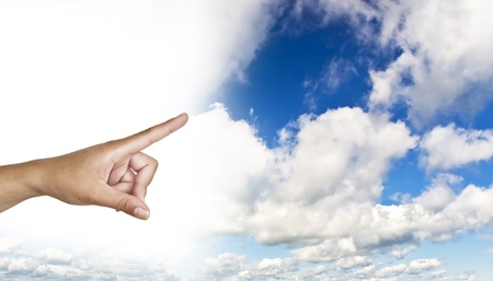 hand on the blue clear sky. Woman