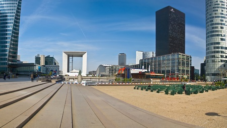 PARIS FRANCE - APRIL 14: Business district La Defense April 14, 2011 in Paris, France. Panorama of La Defense. View of the Grand Arch - monumental building in the district La Defense, west Paris suburb in the commune Puteaux. Was inaugurated in July 1989. Publikacyjne