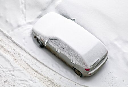 Parked car covered with snow  Russian winter with large snowfall  Top view