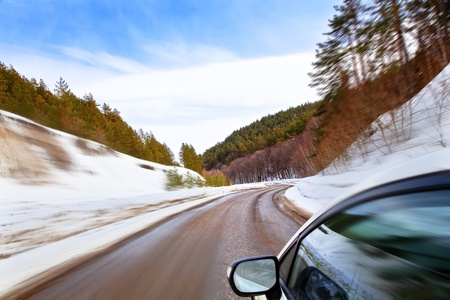 cars on road: car moves along the winding roads of winter  Winter Landscape, motion blur  Stock Photo