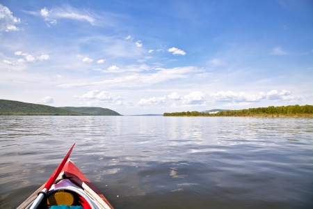 kayak on the water  Against the background of Zhiguli Mountains  The Volga River near Samara