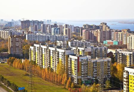 Sleeping area of social housing in the city of Samara. Against the background of the Volga and the houses under construction in the city center. The urban landscape. Stock Photo