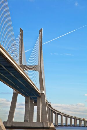 Vasco da Gama bridge in Lisbon, Portugal. On Blue Sky Zdjęcie Seryjne - 16727064