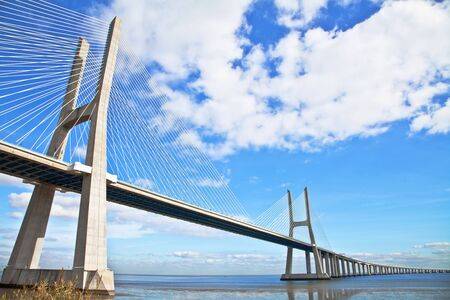 Vasco da Gama bridge in Lisbon, Portugal. On Blue Sky Zdjęcie Seryjne