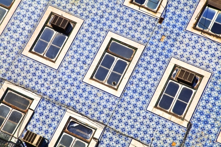 Lisbon windows. Wall with blue title and windows Stock Photo
