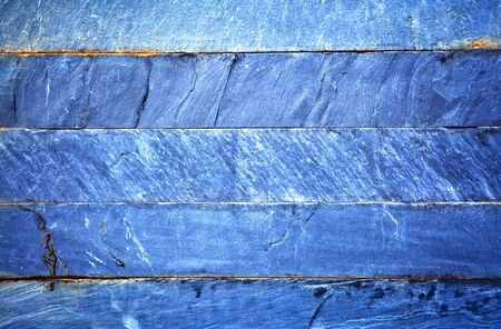 Close up of a blue brick-wall, texture background. Pattern of cracked real stone wall surface with cement Stock Photo