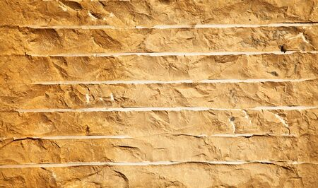 Close up of a brick-wall, texture background. Pattern gray color of cracked real stone wall surface with cement Stock Photo