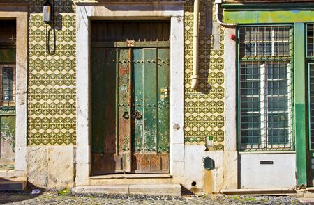 Exterior doors and tiled building in Lisbon, Portugal