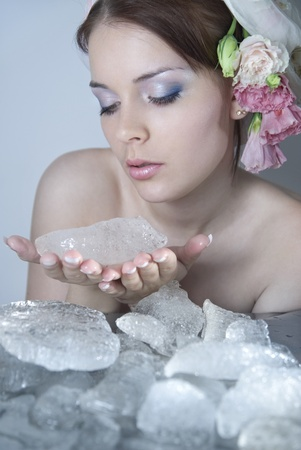 The beautiful young girl in a role of spring which kindles winter ice Stock Photo - 9327574