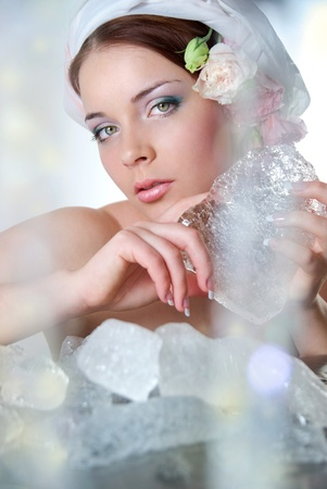 youngly: The beautiful young girl in a role of spring which heats winter ice