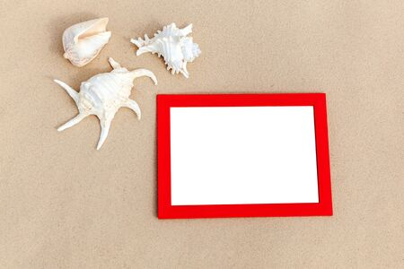 frame: photo frames on sand with sea shells memories of traveling on the sea Stock Photo