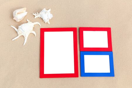 animals frame: photo frames on sand with sea shells memories of traveling on the sea Stock Photo