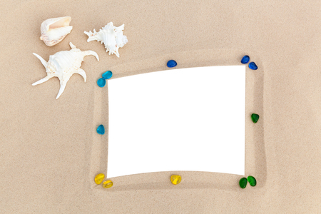 photo frames on sand with sea shells memories of traveling on the sea Standard-Bild