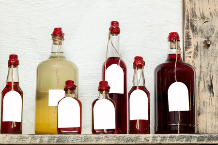 liqueurs: glass bottles of different sizes with liqueurs sealed with wax