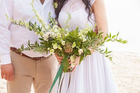 fiancee: a wedding bouquet is in the hands of fiancee