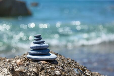 rock pile: A small Zen out of a pile of stones on a rock,Stone balance Stock Photo
