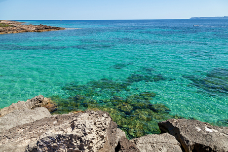 shores: Rocky shore. Rocky shore with crystal clear water through which can be seen all the bottom. From the shores offers stunning views on the vast expanses.
