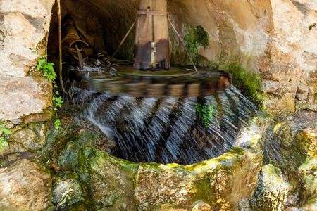 Water Mill. Water mill Fyakkati Fiaccati located in the rock. Thanks to high pressure water mill as quickly rotates and accelerates large water flows. Banco de Imagens
