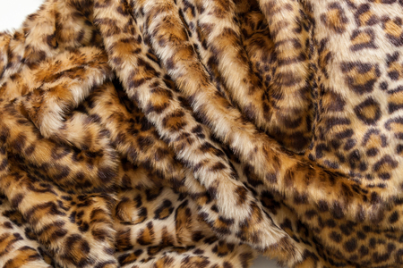 detailed shot: Leopard fur textile. The folds of the leopard fur textile close up. Stock Photo