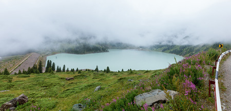 thick white mist over the Big Almaty Lake, large natural reservoir of fresh water