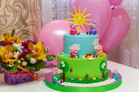 b: KIEV, UKRAINE - 14.10.2016  Custom cake. Bright and big custom B-day cake for a children party.