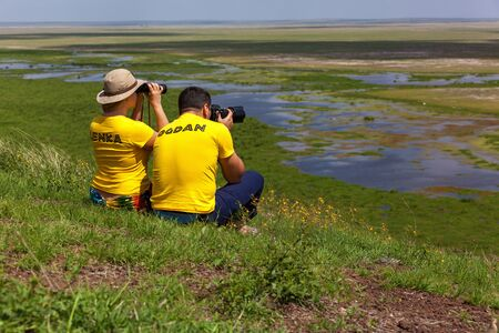 Amboseli, Kenya  10 January 2013 tourists look and take pictures landscape in Amboseli National Park Editorial