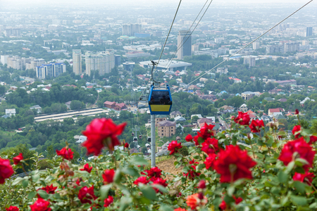 Almaty city view from Koktobe hill and cabin of cable car, landmark in Almaty Kazakhstan