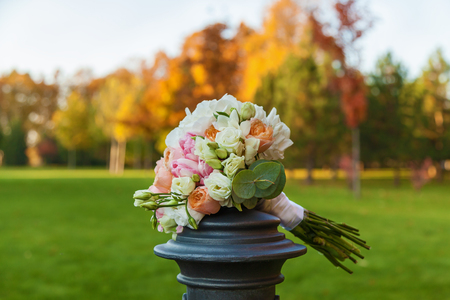 wedding bouquet on a background of colorful autumn forest Stock Photo